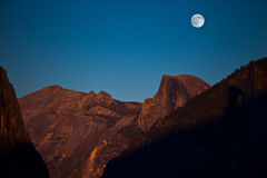 Fullmoon over Halfdome. A fullmoon moonrise over Half Dome during sunset.  Yosemite National Park.  Canon EOS 5d Mk2 Stock Images