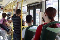 Fullsatt folk i bussen Royaltyfria Foton