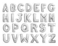 Fullt alfabet av metalliska uppblåsbarballonger för silver Arkivbilder