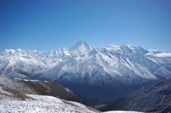 Fullview of Mount Gongga. Mount Gongga, also known as Minya Konka, is the highest mountain  in Sichuan, China. It is situated in the Daxue Shan mountain range Royalty Free Stock Photos