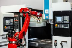 Fully automated CNC machining. With handling robot royalty free stock image