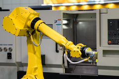 Fully automated CNC machining. With handling robot Royalty Free Stock Photos