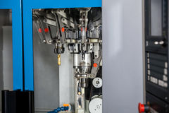 Fully automated CNC machining. Turning and milling center with changing spindle Stock Photos