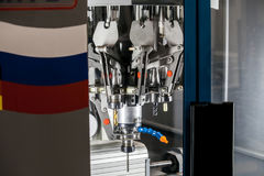 Fully automated CNC machining. Turning and milling center with changing spindle Royalty Free Stock Photos