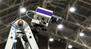 Fully automated timing system camera indoor. A fully automated timing system camera on a ladder in an indoor track and field center royalty free stock image
