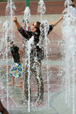 Fully Clothed Man Gets Triumphantly Soaked Standing In Atlanta Fountain Stock Image