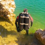 Fully equiped diver ready to dive in the sea. Close up view. Stock Image
