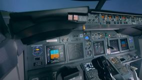 Fully-equipped empty cockpit of a flight simulator stock footage