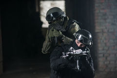 Fully equipped military men with automatic weapons. Playing in airsoft strikeball royalty free stock images