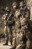 Fully equipped military men. In camouflage uniform Royalty Free Stock Photography