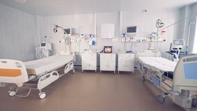 Fully-equipped spacious hospital ward with two empty beds stock footage