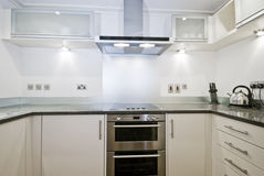 Fully fitted contemporary kitchen in white Stock Photos