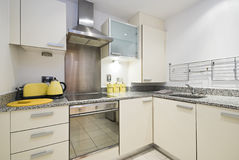 Fully fitted modern kitchen. In italian vanilla with kitchen appliances Stock Image