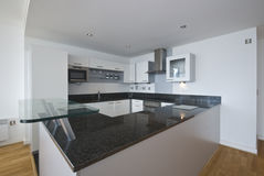 Fully fitted modern kitchen in white Stock Photography