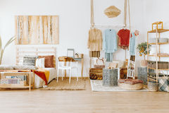 Fully furnished bedroom. Bright cozy fully furnished bedroom with modern wardrobe Royalty Free Stock Photo