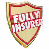 Fully Insured Gold Shield Insurance Policy Coverage. Fully Insured words on a gold shield with 3d letters to illustrate 100 percent coverage with a good Stock Image