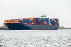 Fully laden container ship in port Royalty Free Stock Images
