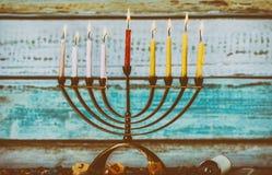A fully lit menorah Glowing Hanukkah Candles. A fully lit menorah Glowing Hanukkah Burning Candles royalty free stock photos