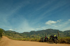 Fully Loaded Bikes on dirt road Royalty Free Stock Images