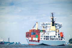 A fully loaded containership enters the harbor of Hamburg Stock Images