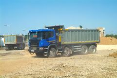 Fully loaded modern dump trucks preparing to on construction sit. Fully loaded modern dump truck ready to unload soil on construction site Stock Photography