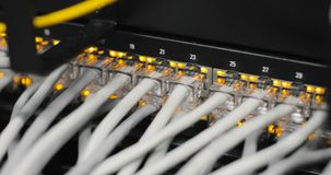 Lights and connections on network server. loaded network media converters and ethernet switches. Fully loaded network media converters and ethernet switches stock footage