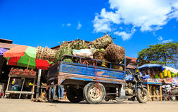 Fully loaded pickup motor with fruits on a market. In Africa Royalty Free Stock Images
