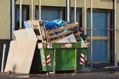 Fully loaded skip on a construction site Royalty Free Stock Photography