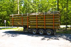 Fully loaded truck trailer with wooden pallets surrounded with wooden boards without Truck royalty free stock image
