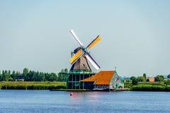Fully operational historic Dutch Windmills along the Zaan River Stock Image