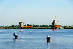 Fully operational historic Dutch Windmills along the Zaan River Stock Photography