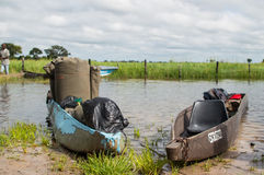 Fully packed Mokoros before a Mokoro Trip in the Okavango Delta Stock Photography