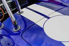 Fully restored  Shelby Cobra. Fully restored blue with white racing stripes Shelby Cobra Royalty Free Stock Photos