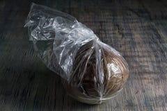 Fully ripe borojo fruit in plastic bag. Fully ripe borojo fruits are kept in plastic bags on room temperature Royalty Free Stock Photography