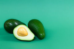 Fully ripened avocado on a green background Royalty Free Stock Image