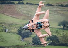 Fully weapanised fighter jet. Fully weaponised RAF GR4 Tornado fighter jet with Enhanced Paveway III laser guided bombs in flight Royalty Free Stock Photos