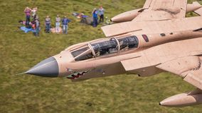 Fully weapanised fighter jet. Fully weaponised RAF GR4 Tornado fighter jet in operation Desert Storm colour scheme.  25 years since operation Granbe saw the Stock Photo