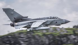 Fully weapanized fighter jet. Fully weaponized RAF GR4 Tornado fighter jet in flight Stock Images