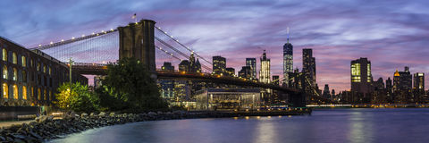Fulton Ferry Park Twilight Panorama. A colorful twilight view of the Brooklyn Bridge, Jane's Carousel and the Manhattan skyline see from Empire Fulton Ferry Park Stock Images