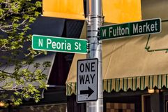 Fulton Market Street and Peoria Street direction information signs. Main street in Chicago. Fulton Market Street and Peoria Street direction information signs royalty free stock photos