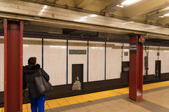 Fulton street subway. NEW YORK - APRIL 27, 2016: Unkknown traveler waiting for the subway to come on Fulton street subway platform Stock Image