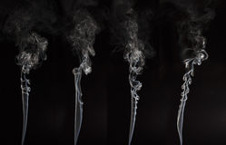 Fumée blanche sur le fond noir Photographie stock