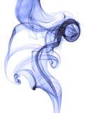 Fumée bleue abstraite sur le fond blanc photographie stock libre de droits