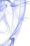 Fumée bleue d'isolement sur le blanc Images stock