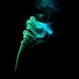 Fumée colorée sur un fond foncé Photo libre de droits