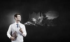 Fumée d'homme d'affaires et de tuyau Photographie stock