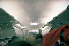 Fumée dans les aéronefs Photographie stock