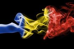 Fumée de drapeau de la Roumanie photographie stock libre de droits
