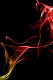 Fumée Jaune-Rouge sur le noir Photographie stock
