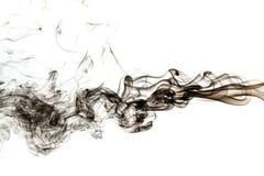 Fumée noire abstraite sur le fond blanc Photographie stock